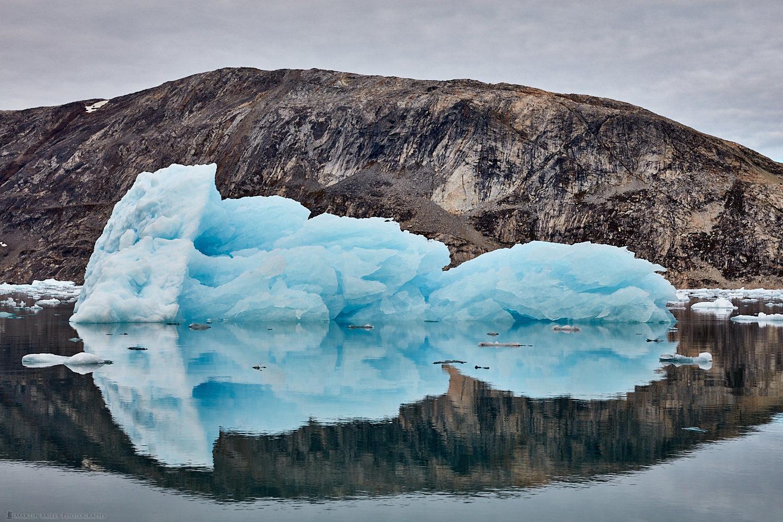 Iceberg and Mountain Reflection