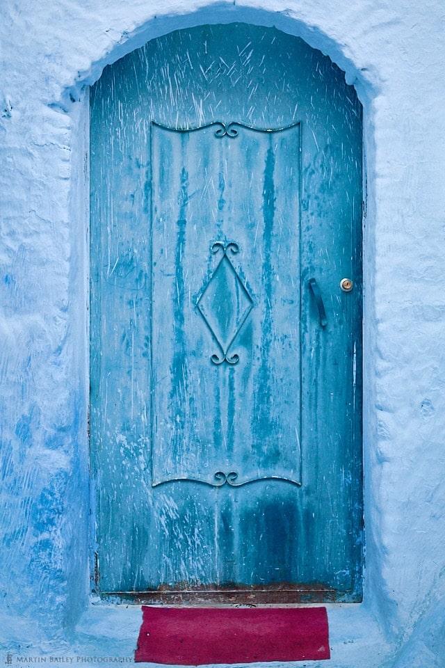 Blue Door with Red Doormat